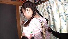 Concupiscent kinky Japanese whore in bondage uses stockings on snake lips