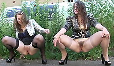 Busty waitress pisses outdoors